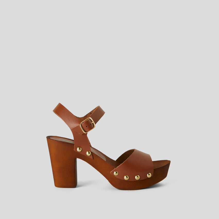 Studded genuine leather clogs
