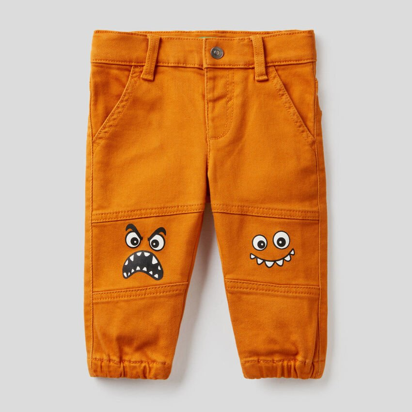 Trousers with character print