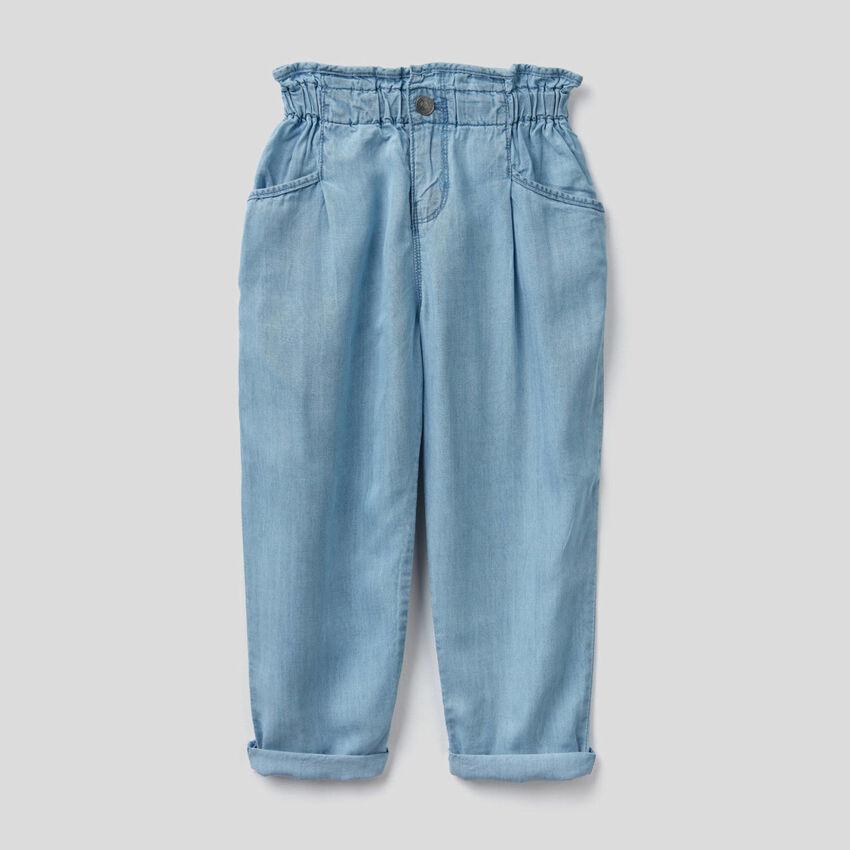 Paper bag trousers in lightweight denim